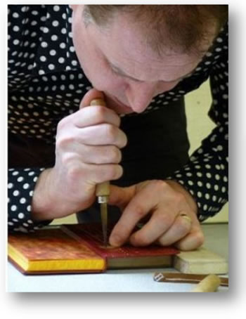 Dominic Riley is a bookbinder, artist and teacher. This is his first visit to Woking.